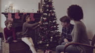 Little girl decorate Christmas tree with her family