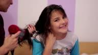 little girl dries hair