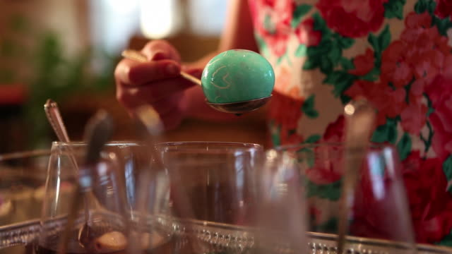 CU Little girl dyeing easter eggs in color water  / Lamy, New Mexico, United States