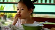little girl eating food