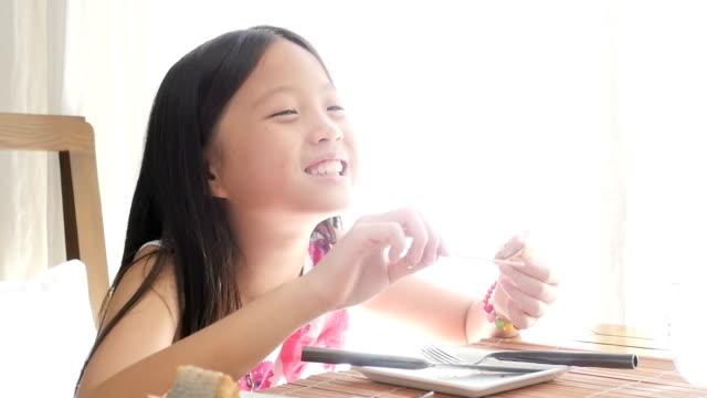Little Girl Eating Yummy cake.
