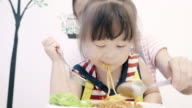 Little Girl Eating Yummy spaghetti.