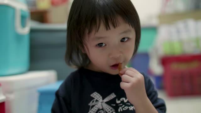 Little Girl Eats Sticky Rice