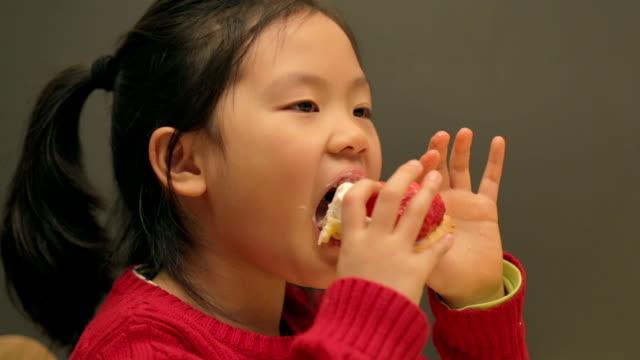 Little Girl enjoying Strawberry Tart