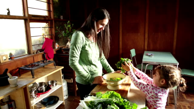 Little Girl helps Mom Making Healthy Food