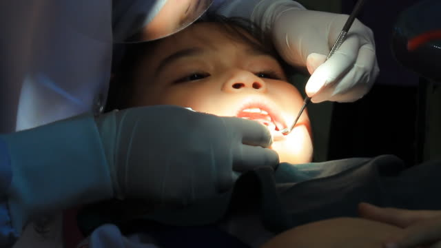 Little girl in dentist office