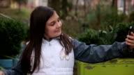 Little girl making selfie on smart phone