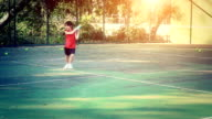 Little girl on the tennis court