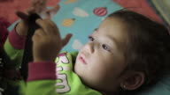 Little girl playing with a digital smartphone