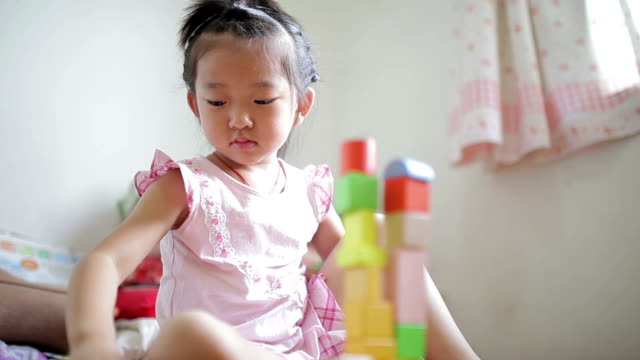 LA Little girl playing with blocks at home /Xi'an, Shaanxi, China