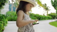 Little girl playing with Smart Phone