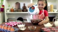 Little Girl Preparing Muffins