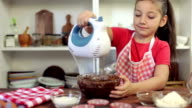 Little Girl Preparing Muffins