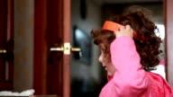 Little girl putinng on a headband
