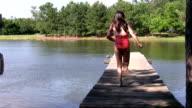 Little Girl Running down the dock HD