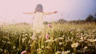 SLO MO Little girl running through meadow