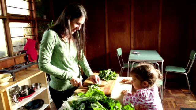 Little Girl runs to Help Mother make healthy Food