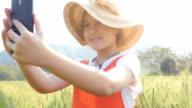 Little girl selfie in the wheat field