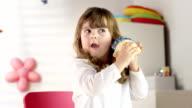 HD DOLLY: Little Girl Shaking Her Piggy Bank