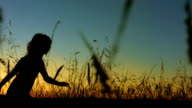 LA TS SLO MO Little Girl Silhouette Running In Grass