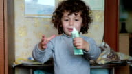 Little girl squeezing the cream tube