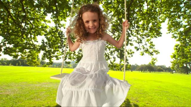 HD SLOW MOTION: Little Girl Swinging On Tree Swing
