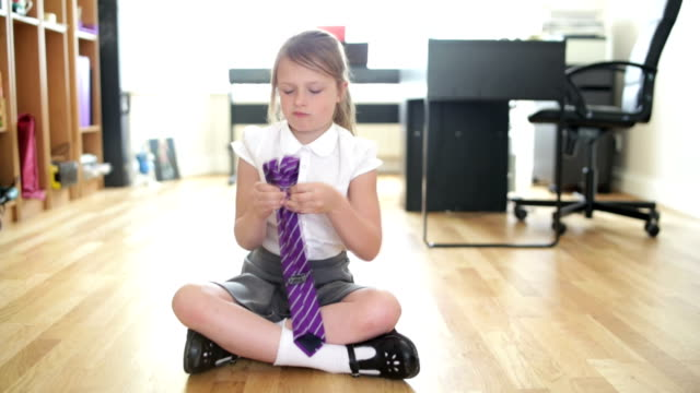 Little Girl Ties her School Tie