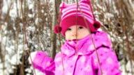 Little girl under the tree