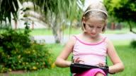 Little girl using ipad tablet computer