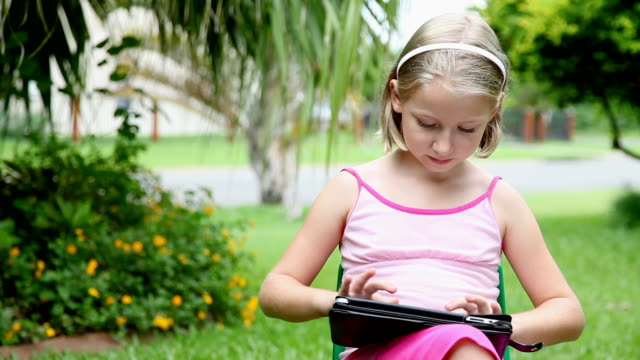 Little girl using ipad tablet computer