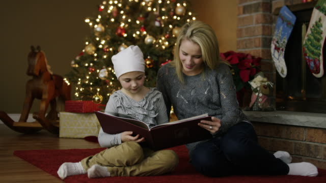 Little girl with leukaemia cancer at Christmas with mother