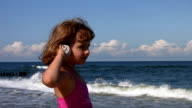 Little girl with shell at the beach