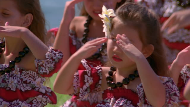 Little girls perform the hula in Maui. Available in HD.