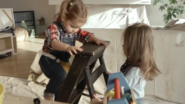 4K - Little Girls Renovation Construction Playing Living Room
