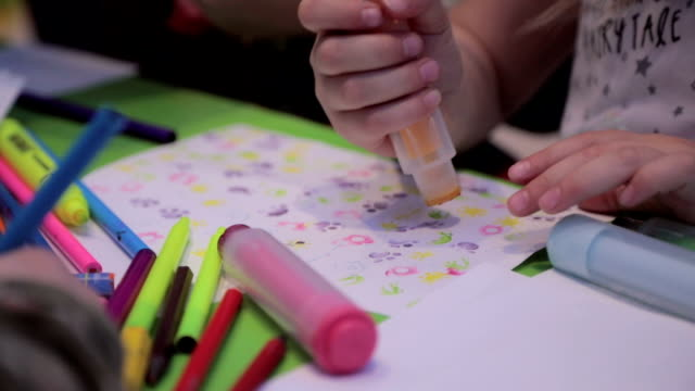 Little Girls Sketching and Drawing in a Preschool Classroom