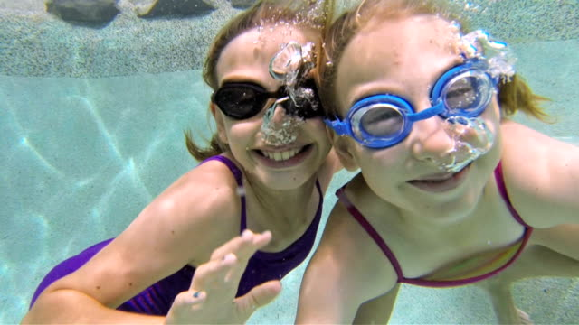 Little Girls Swimming Under Water