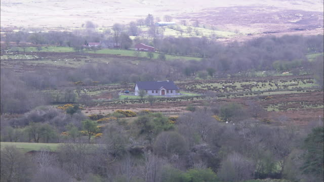 Little house on moor, zoom out to show moors and hills, Northern Ireland