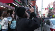 Little Italy, NYC - Mulberry Street Cafes & Tourist Taking A Photo (Christmas Season)