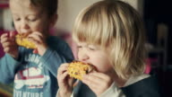 Little Kids Eating Corn on the Cob