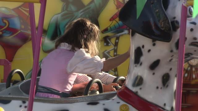 little kids in carousel