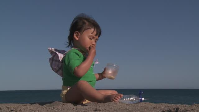 Little Metis Girl eating biscuit.