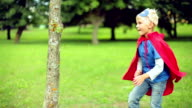Little superman fighting with the tree.