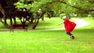 Little superman running in the park.