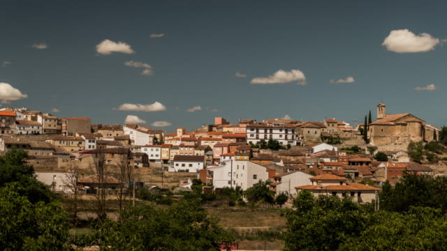 Little town with church and clouds timelapse in spain