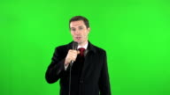 Live TV news reporter on location with Green Screen