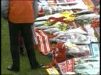 Liverpool Fans Tribute **** FOR ENGLAND SEQ Wreaths laid on pitch as people pay Liverpool respects to dead/ Little girl placing Anfield red teddy...
