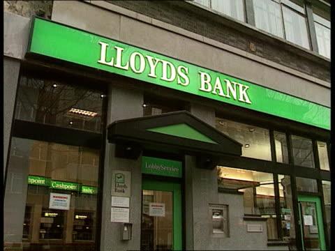Lloyds bank profits ITN LIB LA MS Lloyds Bank sign over entrance LA MS Black horse sign