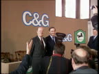 Lloyds bank takeover Cheltenham Gloucester ENGLAND London SW1 CMS Two directors standing for photocall with Lloyds Bank and CG logos on wall behind...