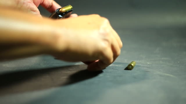 Loading bullets in handgun clip