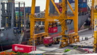 Loading cargo from truck to containership at the Shipping port